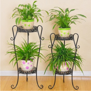 use plant trays to protect wood floors from water