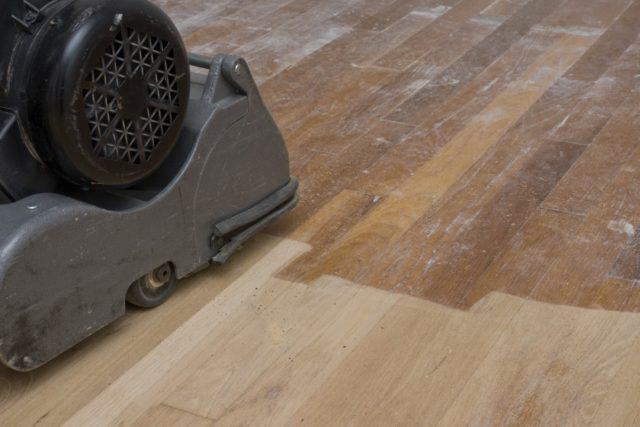 sanding the hard wood floors